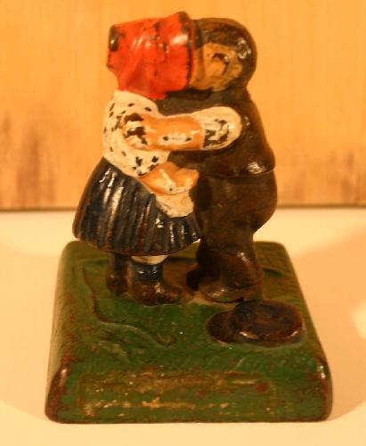 Cast Iron Kissing Kids Paperweight. Approx. 16 oz.